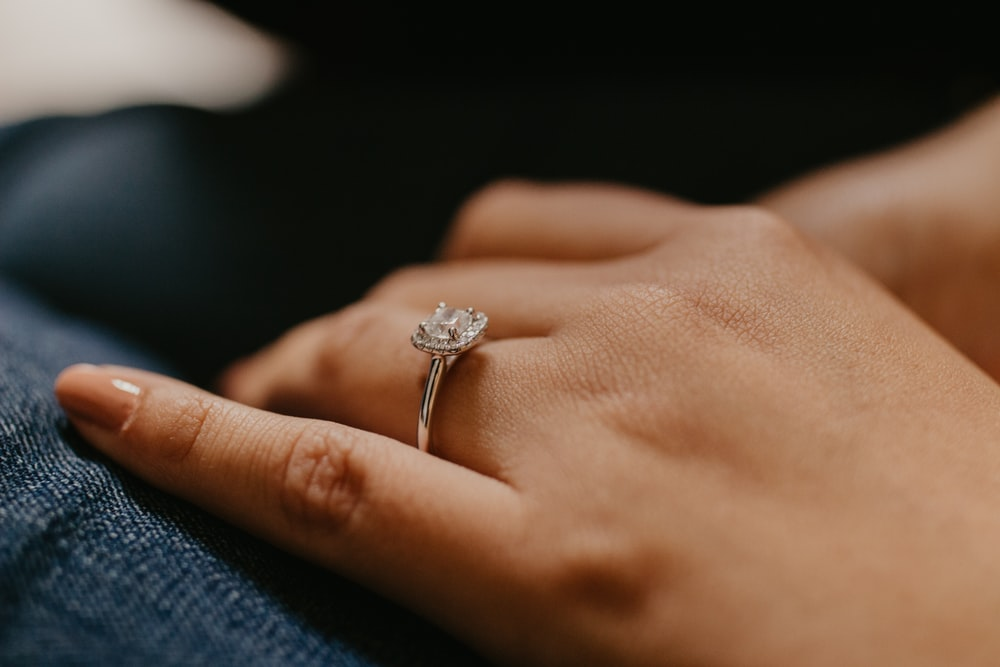 silver-colored solitaire ring