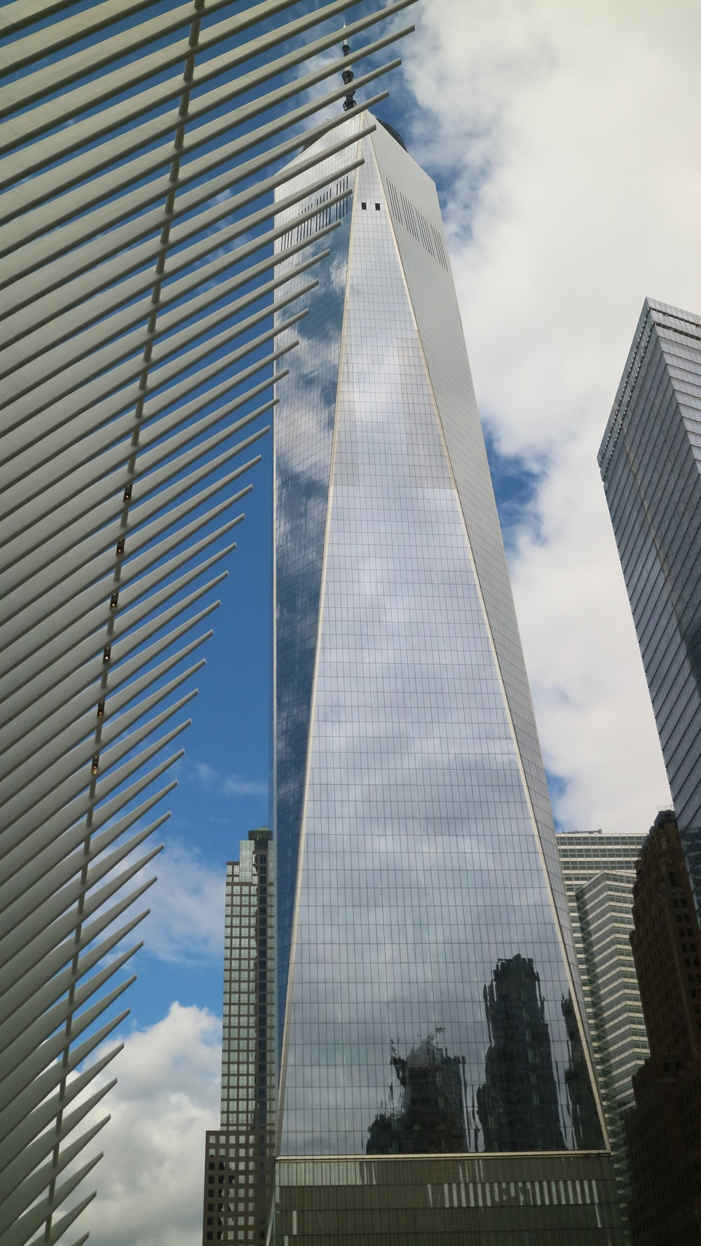 clear glass walled high-rise buildings