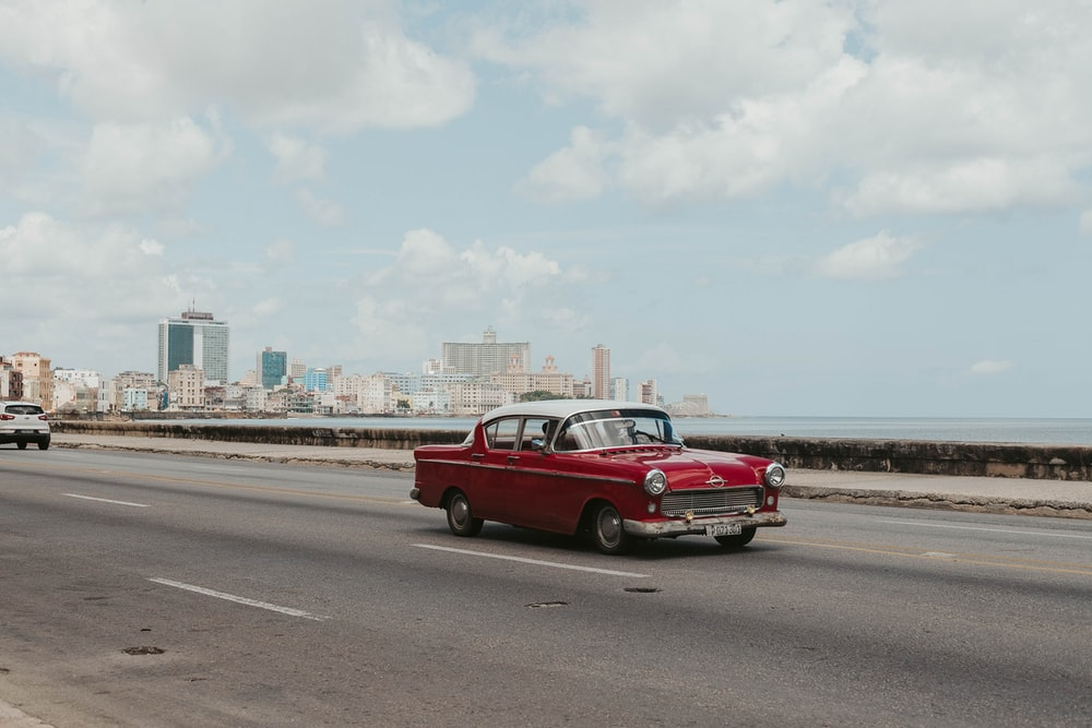 red sedan on road