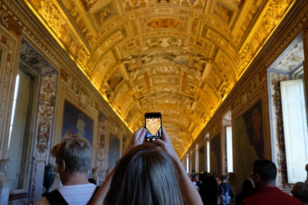 woman taking photo of ceiling