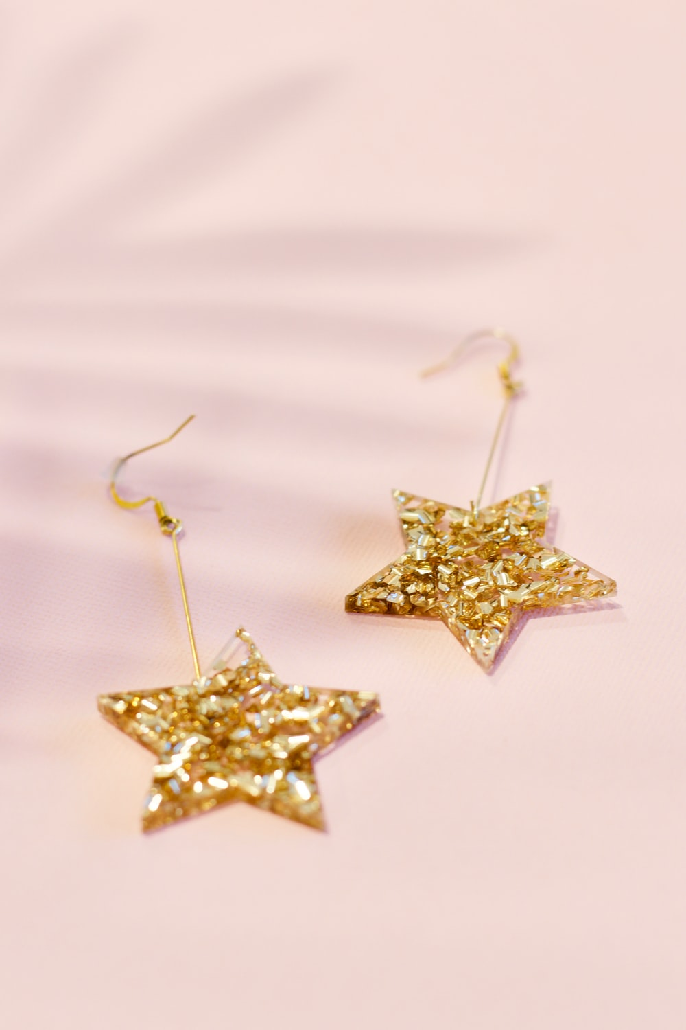 pair of gold-colored star earrings