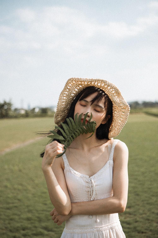 woman holding fern plant
