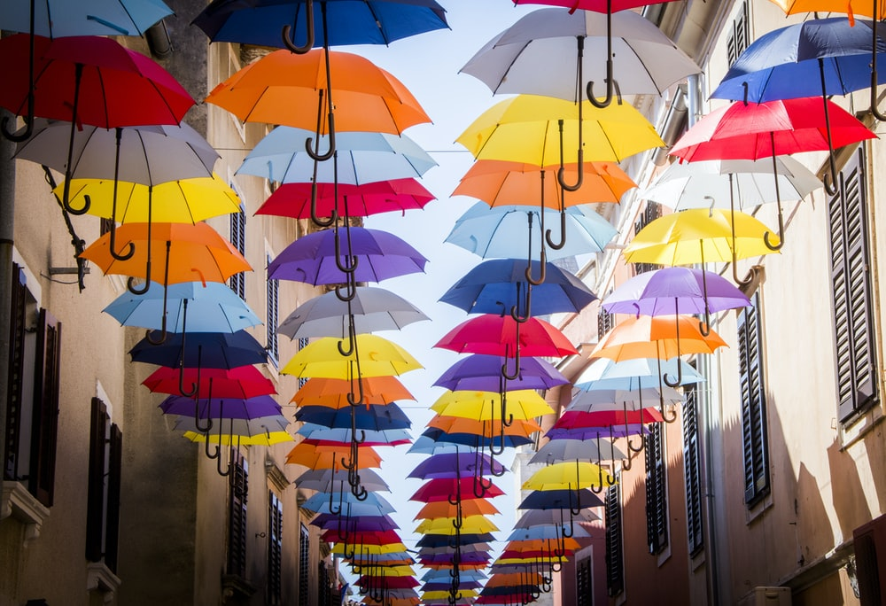 hanged umbrellas on alley