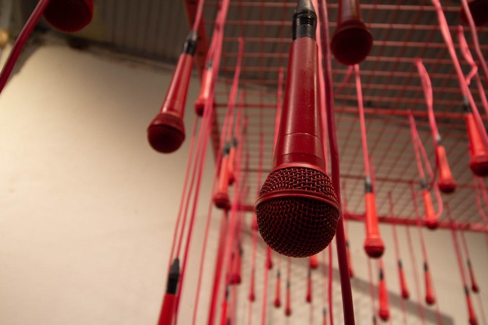 hanged red microphones inside room