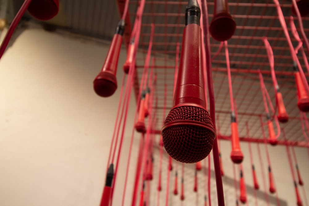 hanged red microphones inside room