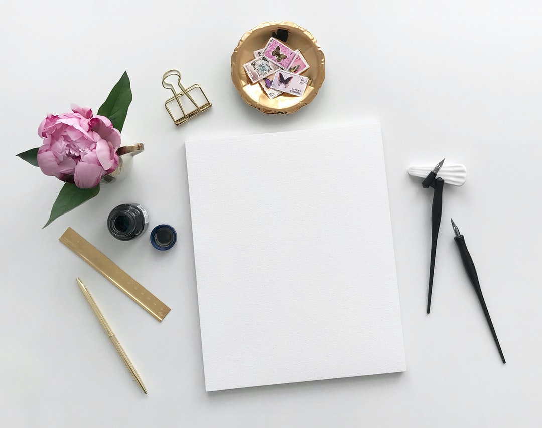 Topview Flatlay with Peony and Pad