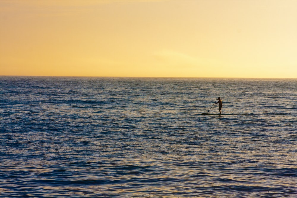 person riding on surfboard