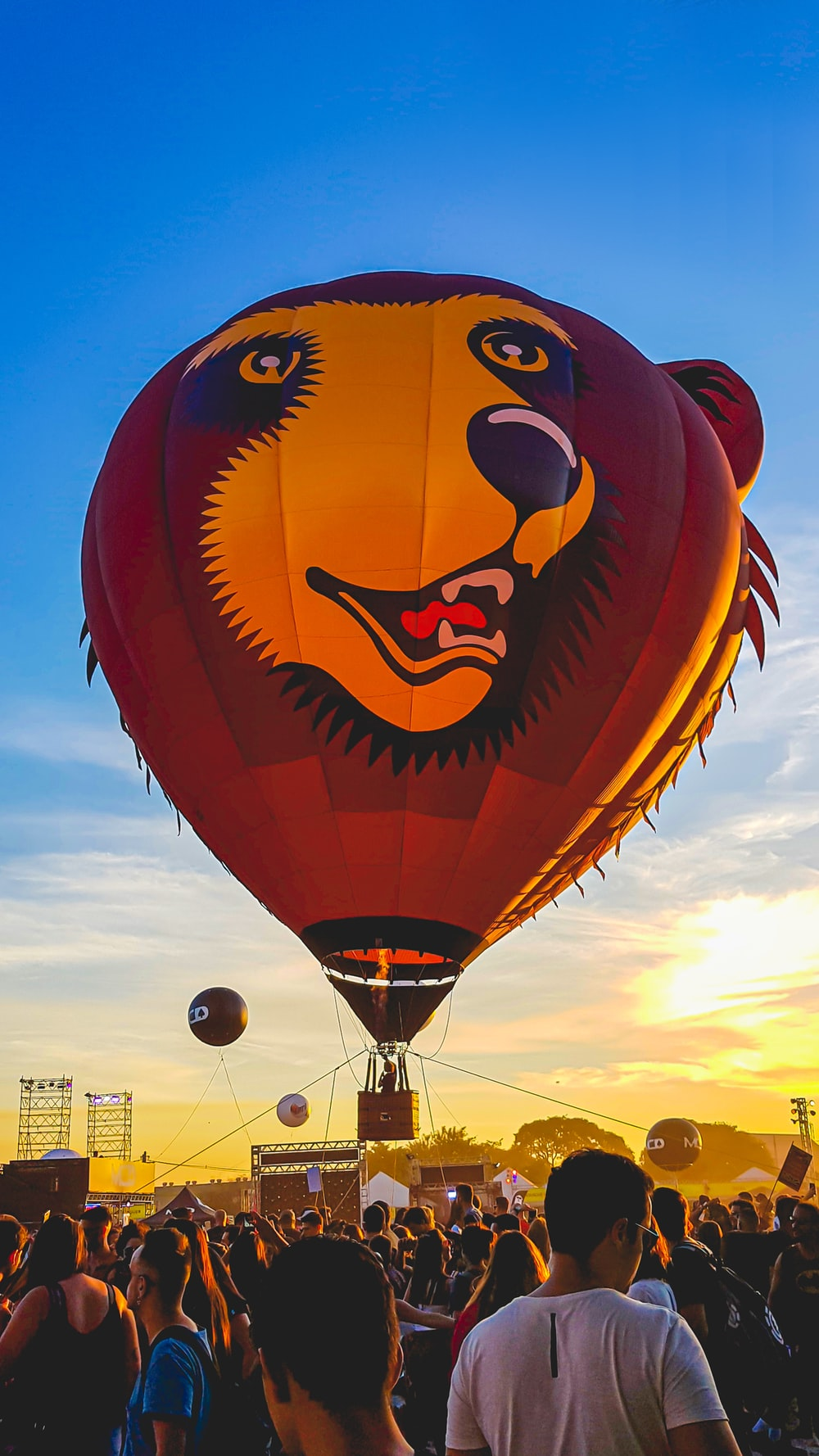 brown hot-air balloon under blue sky