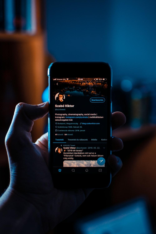 person holding black smartphone