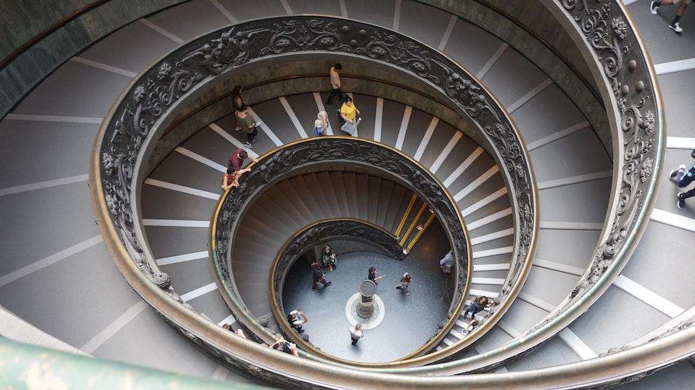 grey spiral stairway inside building
