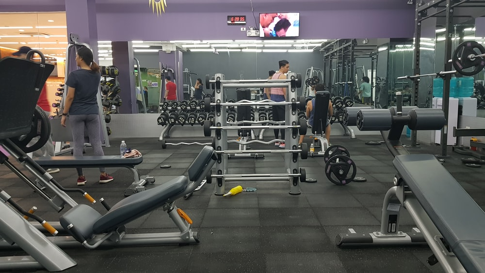 people in gym exercising
