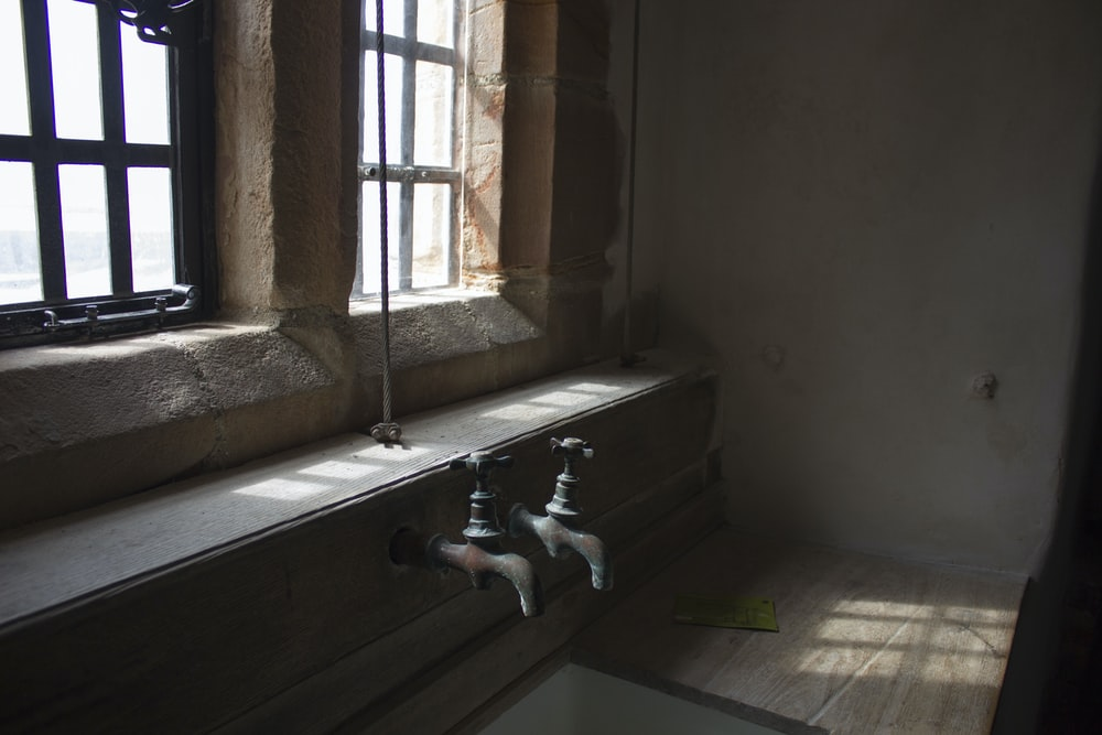 two gray metal faucets