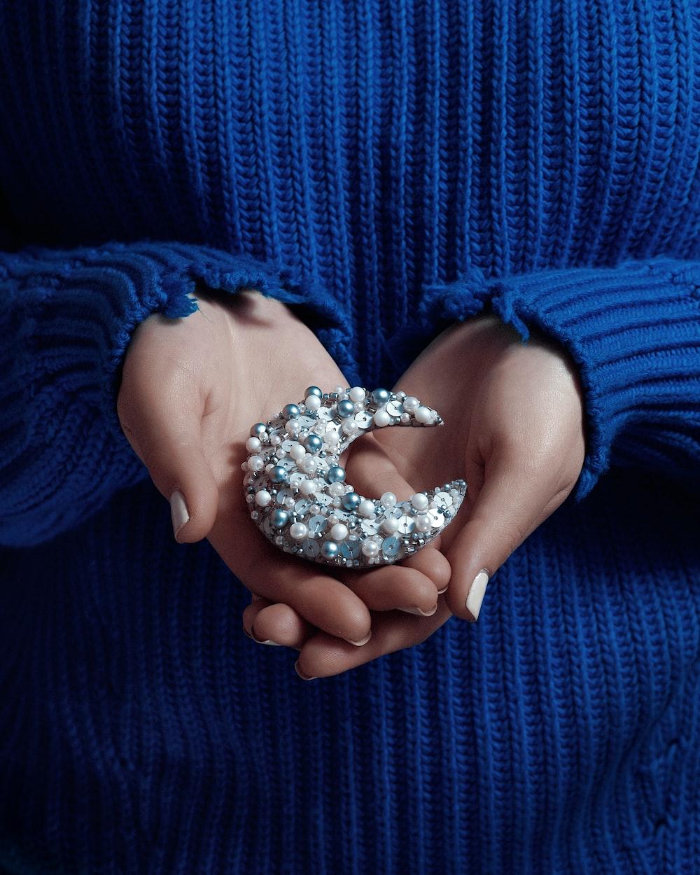 silver-colored crescent accessory