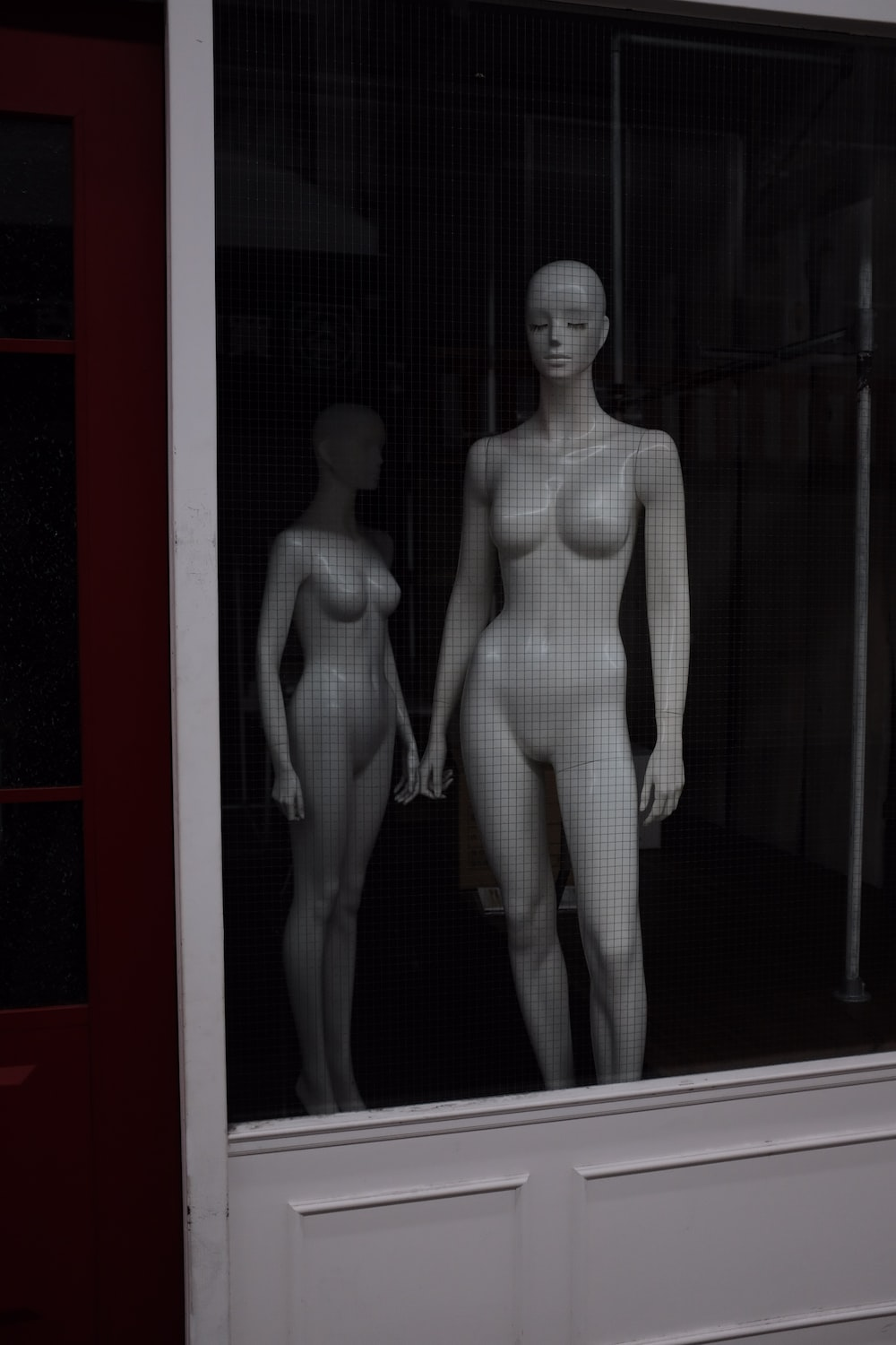 two white female mannequins photo