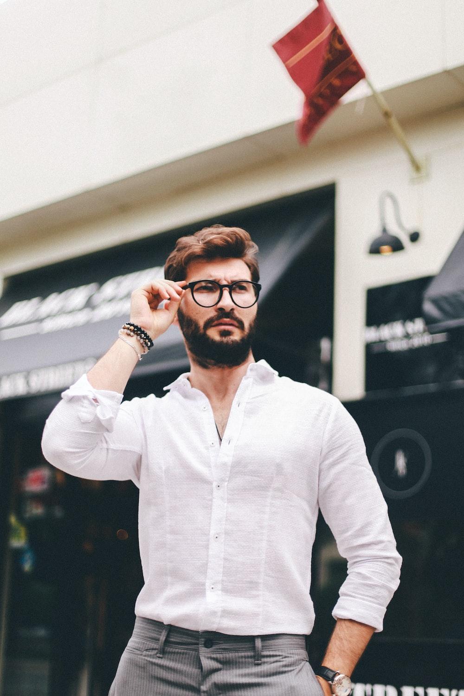 man holding his eyeglasses