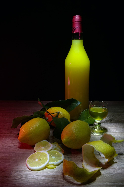 sliced lemon beside glass bottle