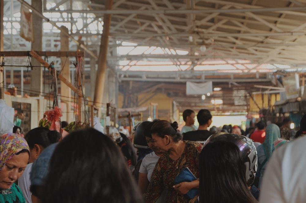 people standing under building