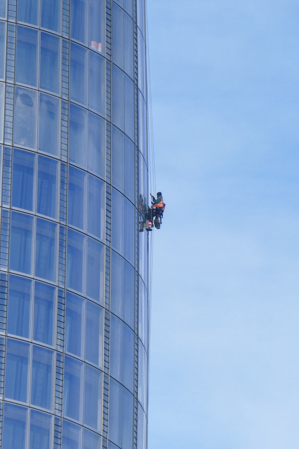person cleaning building windows