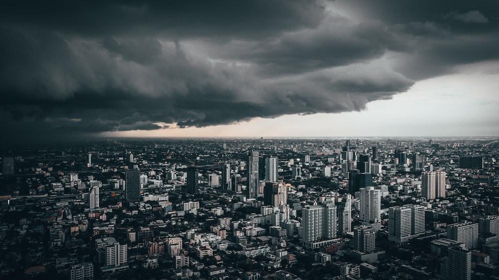 dark cloud above city buildings