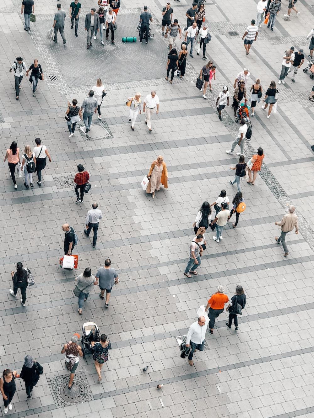 people walking on gray concrete road