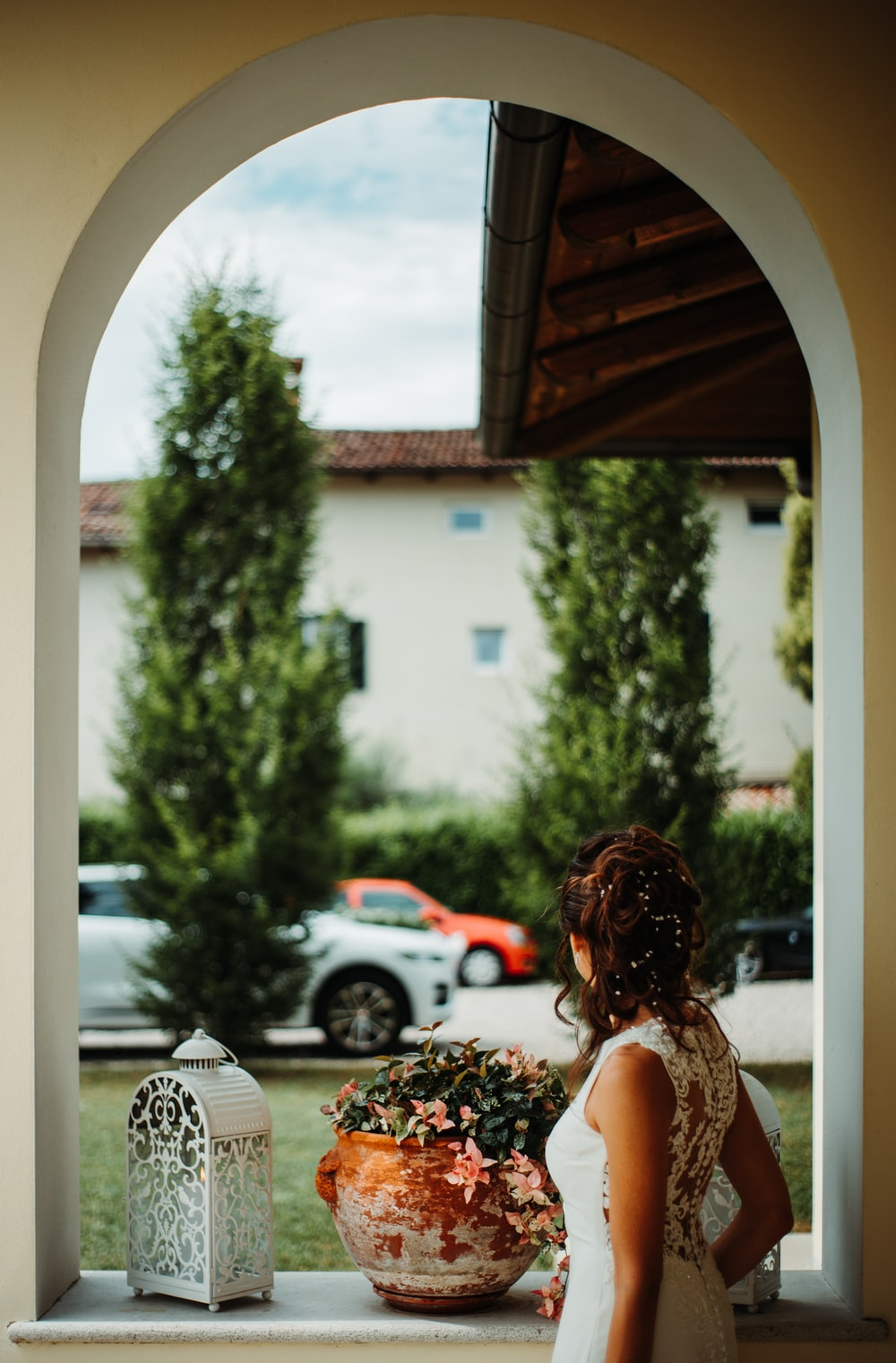woman standing in-front of mirror inside room