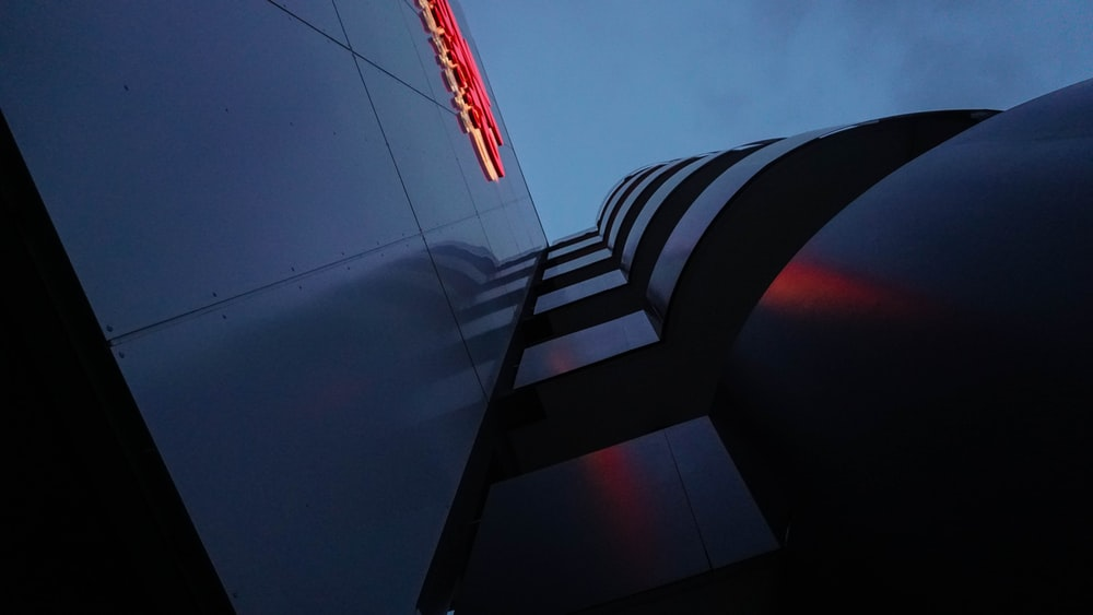 low angle view of building with lighted signage