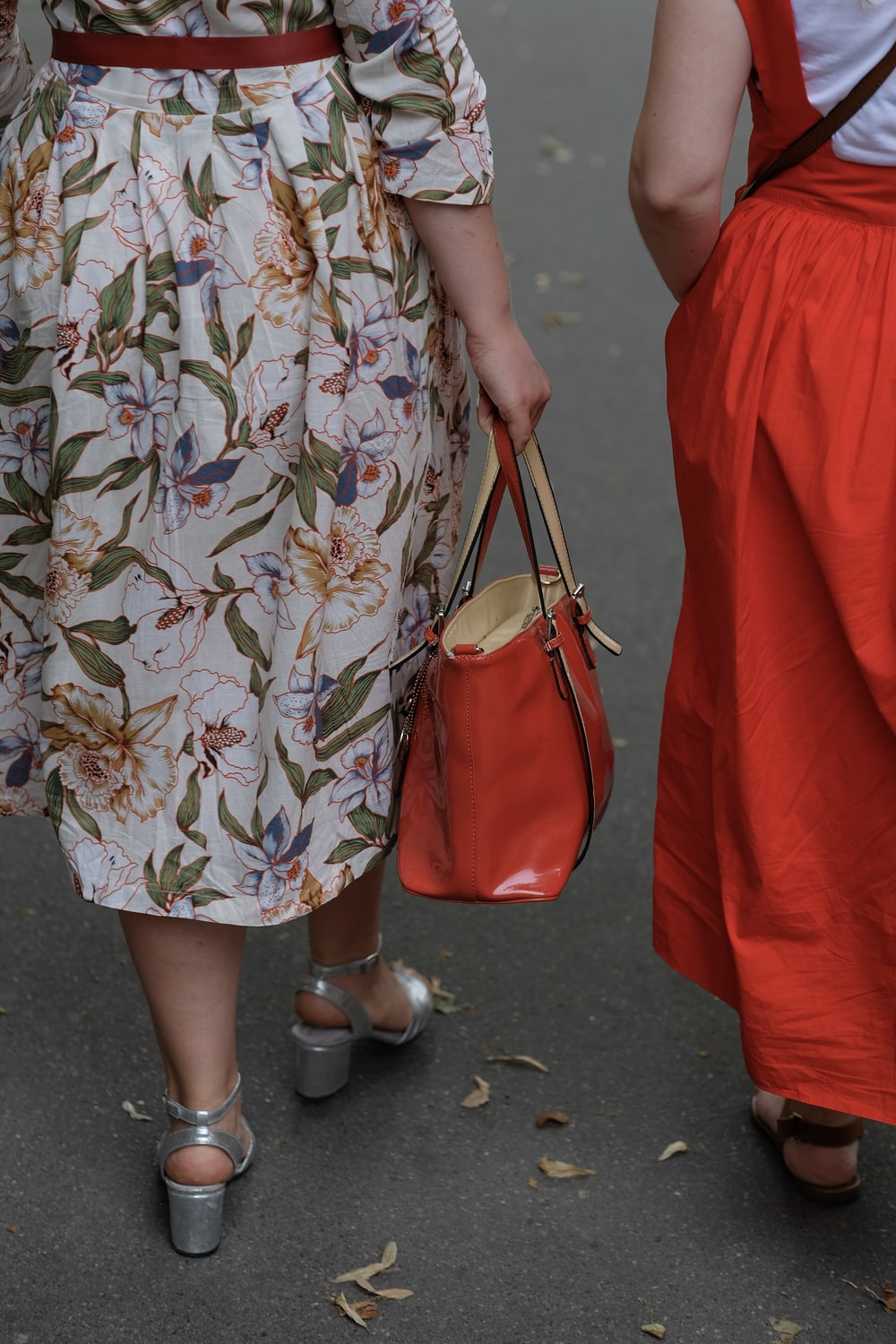 two women's red and white dresses