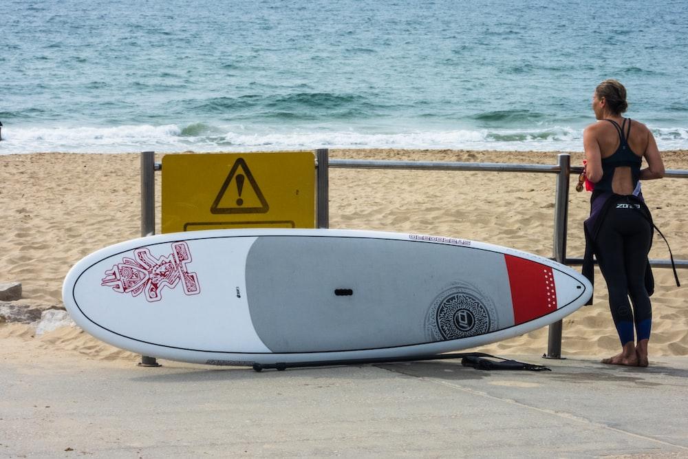 woman standing near surfboard