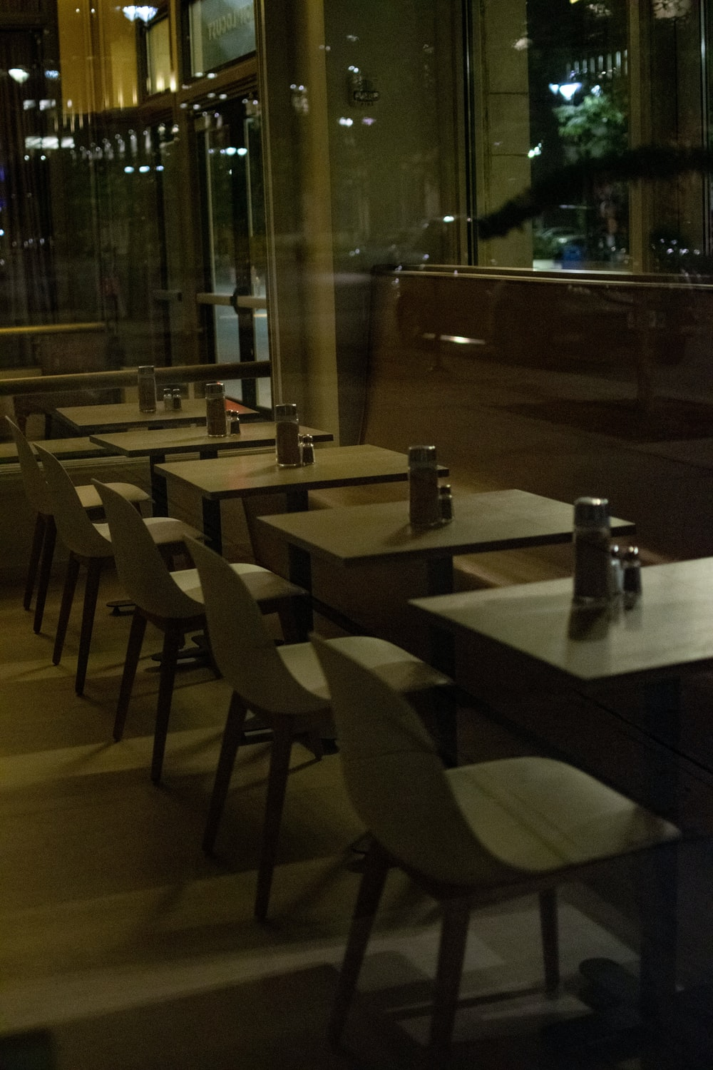 empty brown wooden chairs and tables