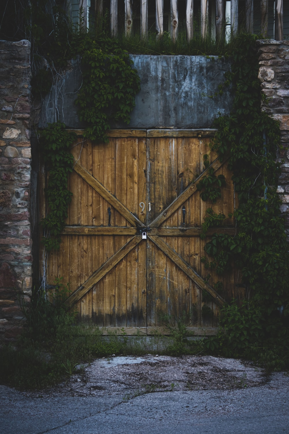 brown wooden gate with plants