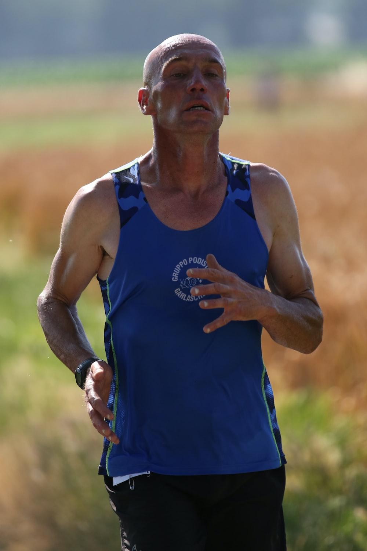 man wearing blue tank top