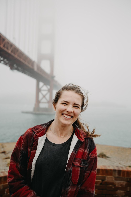 woman smiling near Golden Gate Bridge, San Francisco