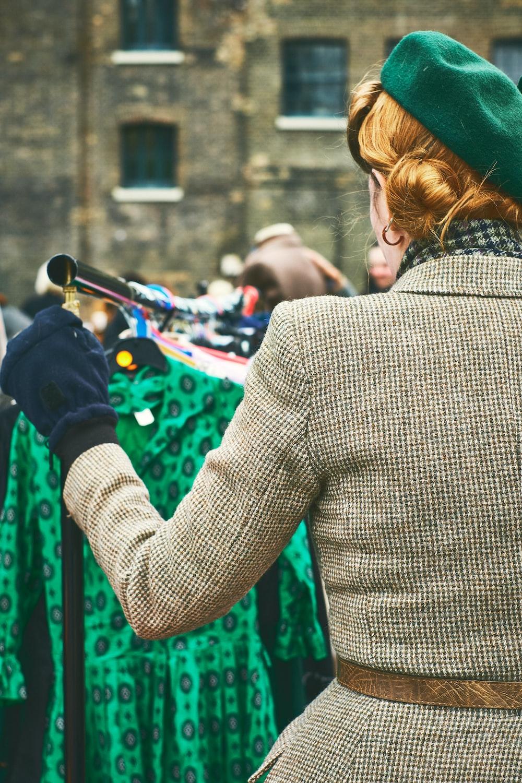 woman looking at green dress