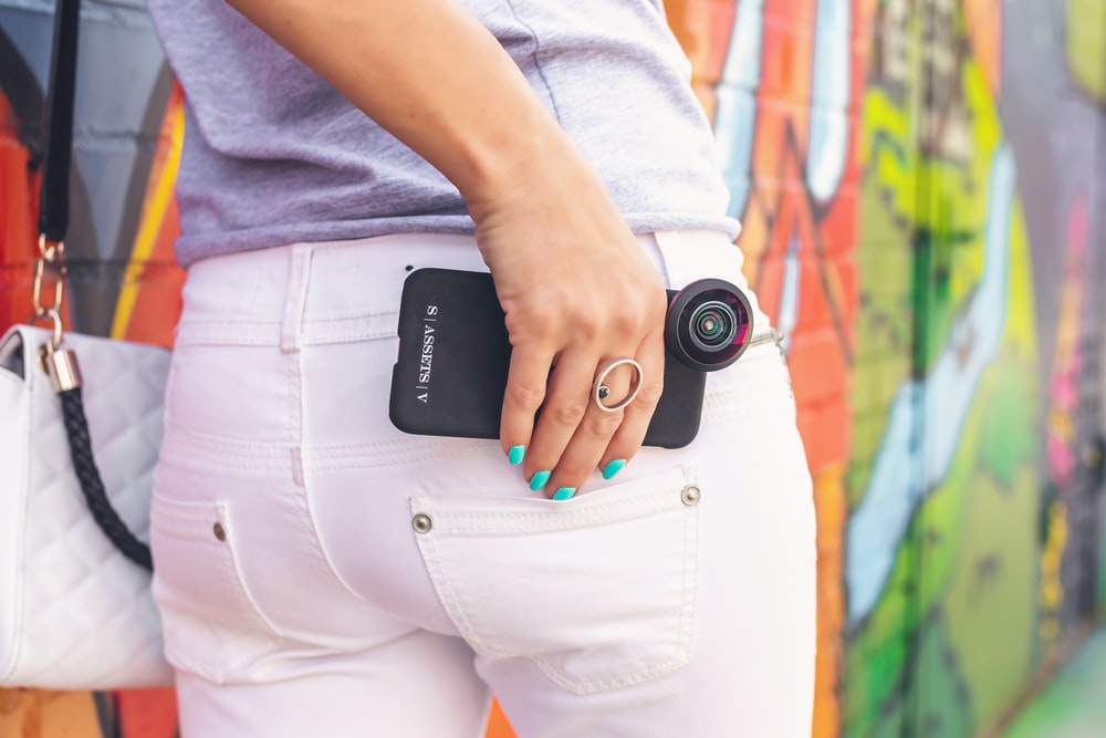 black smartphone with clip-on camera