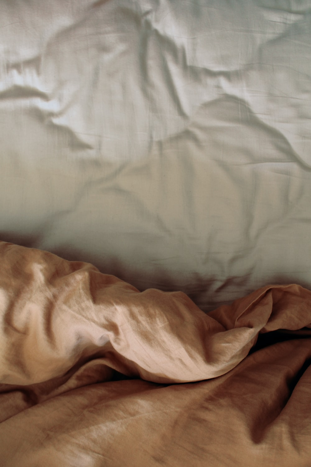 white and brown bed comforter