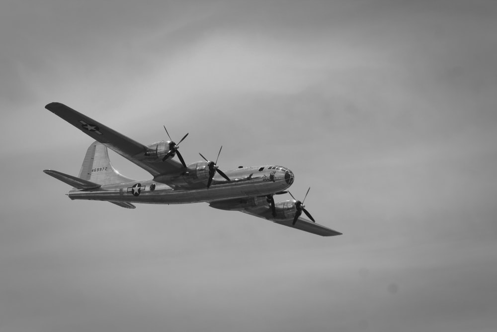 grayscale photography of flying plane