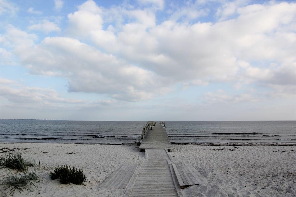 wooden dock on beach shore