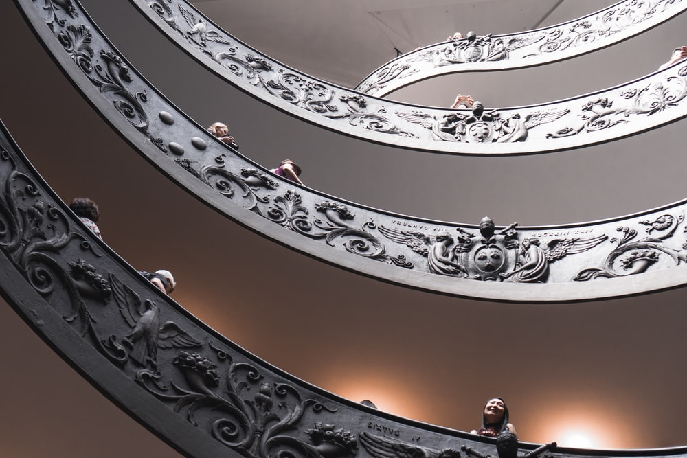 low-angle photography of spiral stairs
