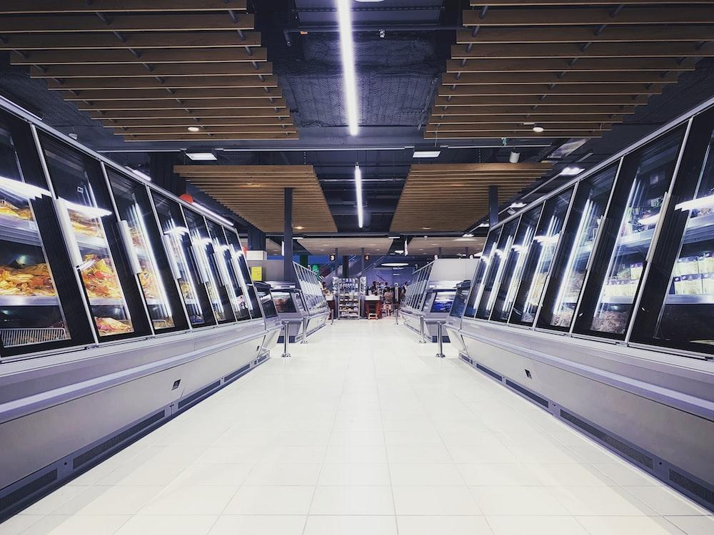 empty hallway between display shelves