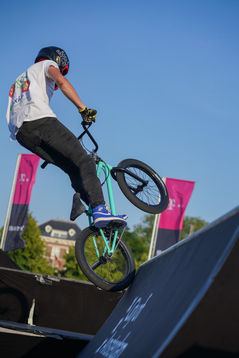 man riding BMX bike