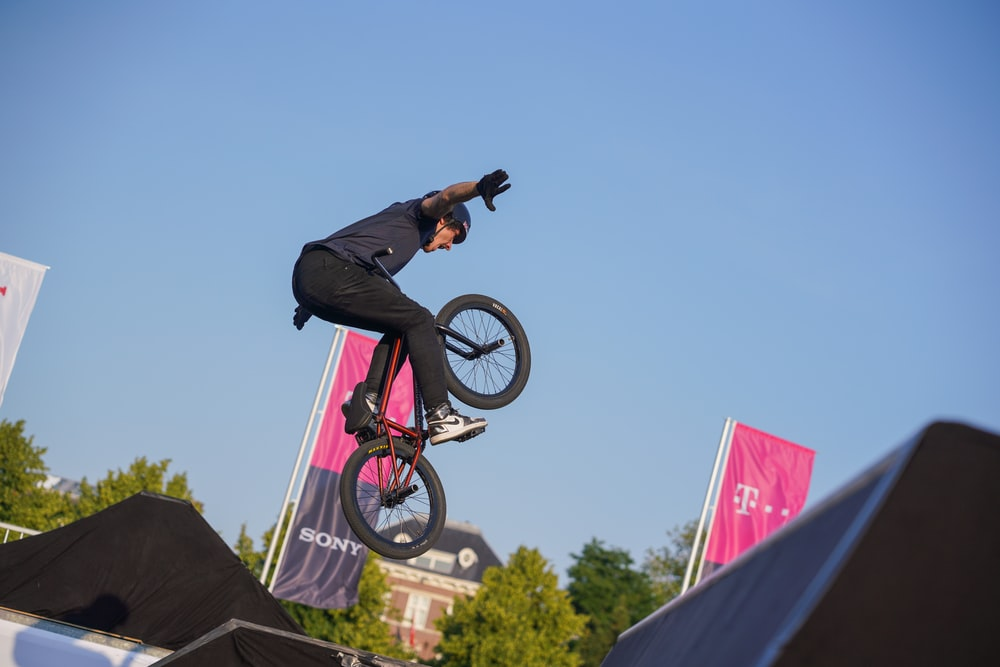 man doing BMX trick in the air