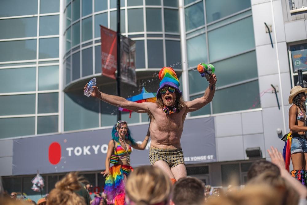 topless man raising both hands