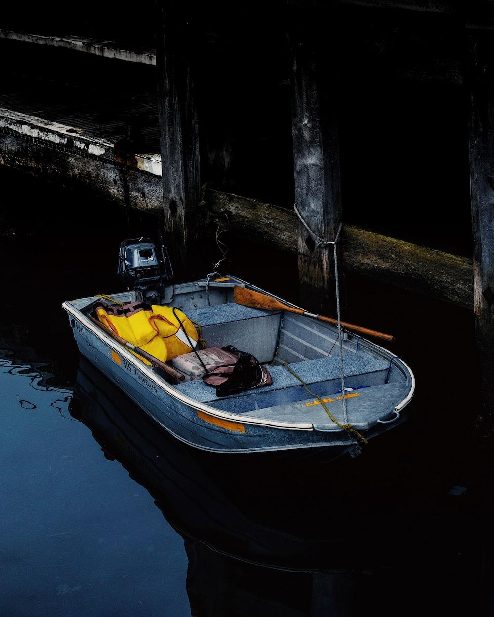 grey jon boat on water