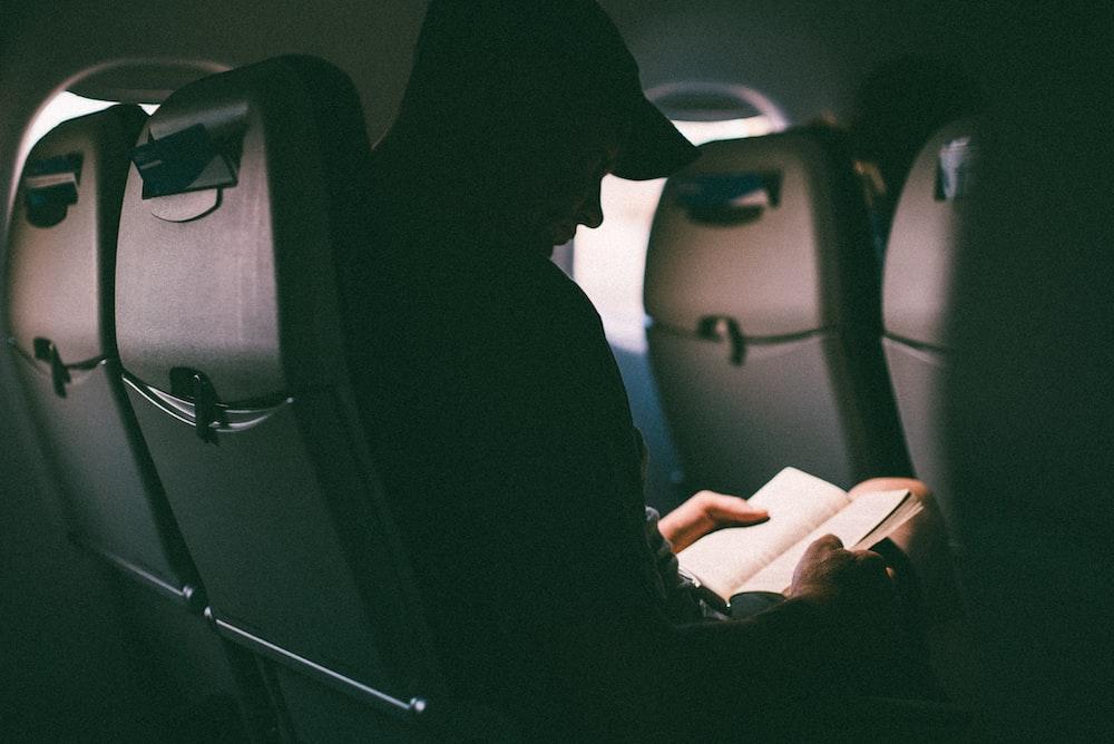 man riding plane