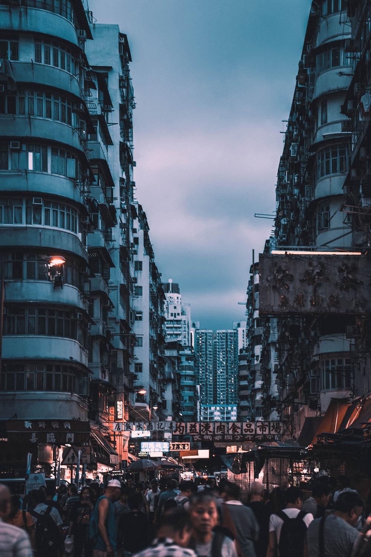 people walking between buildings during nighttime