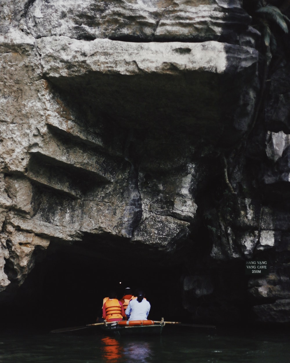 group of people on a boat going in a cave