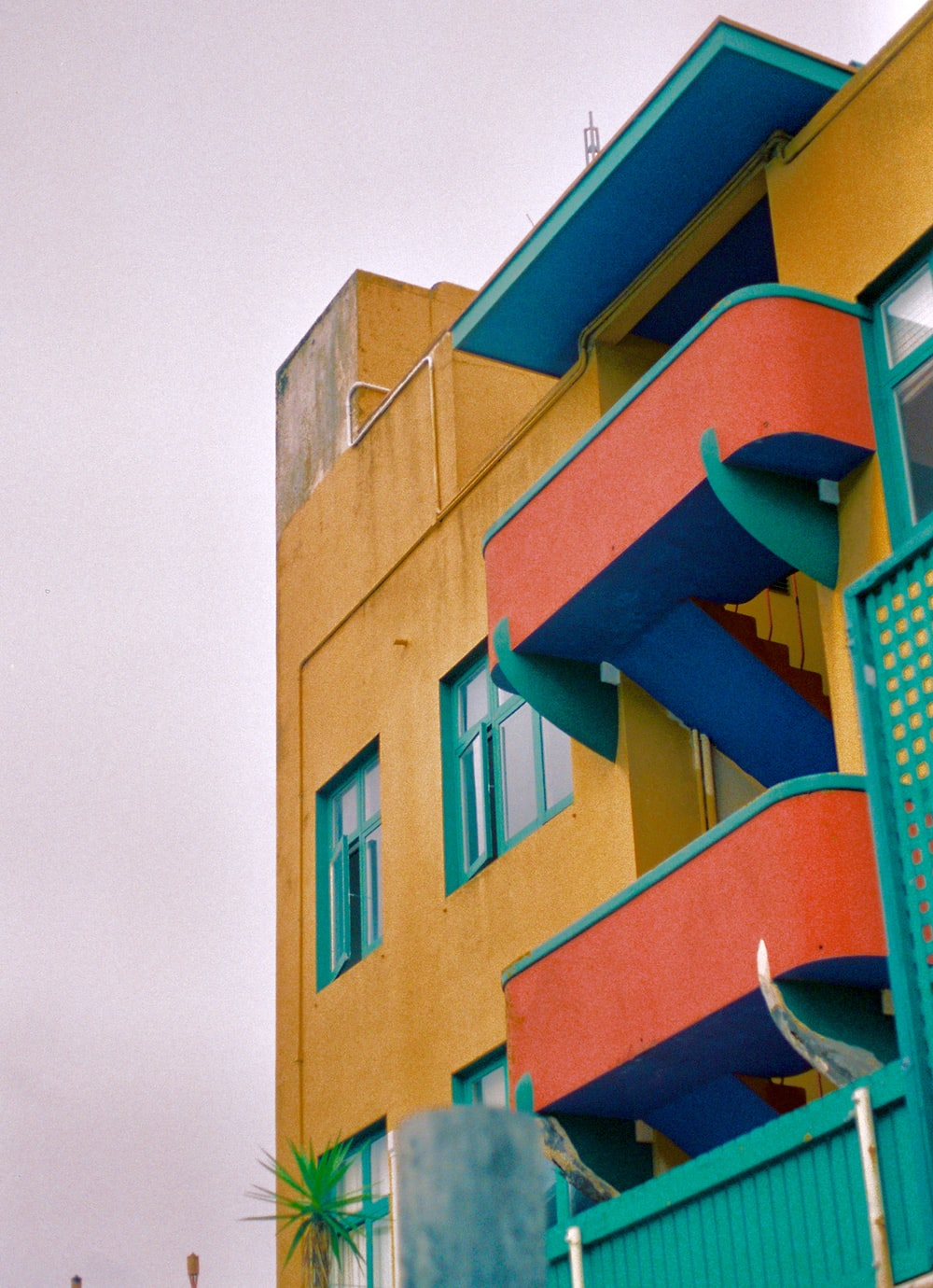 orange, blue, and yellow 4-storey building