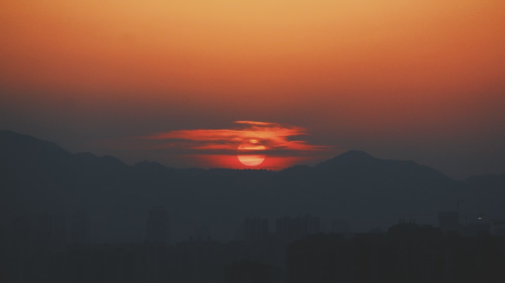silhouette mountain during sunset