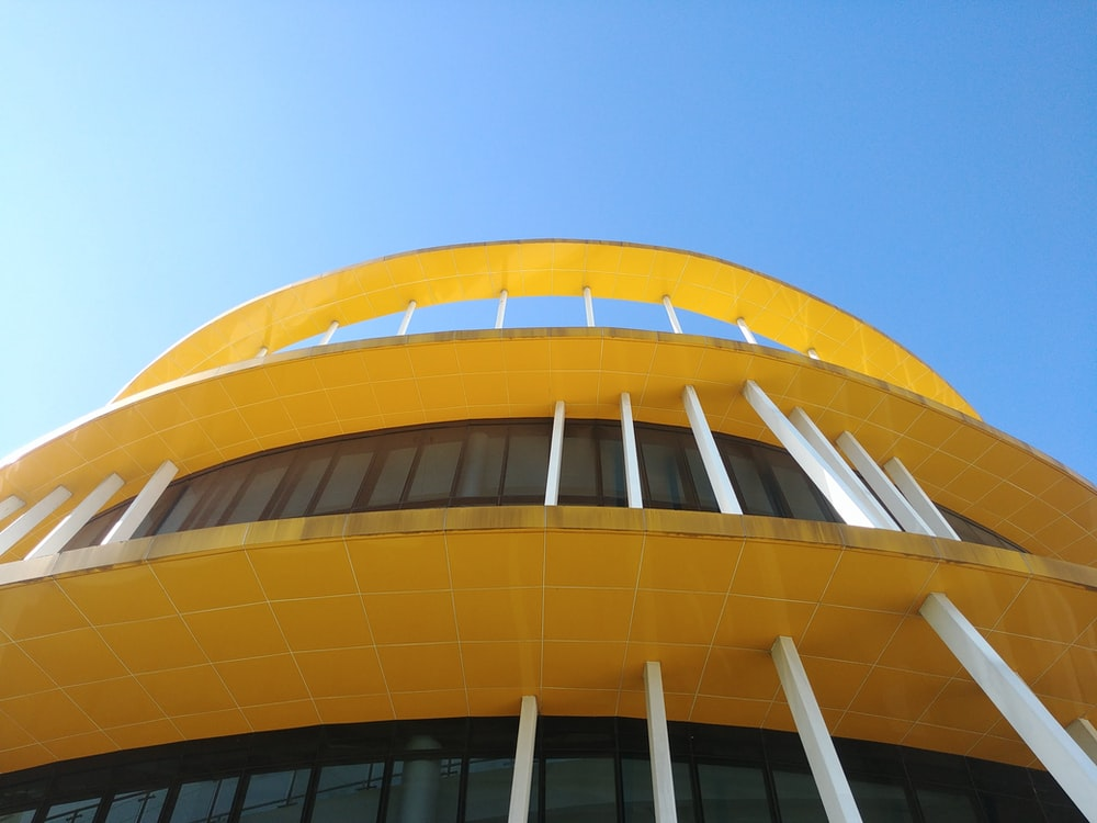 low-angle photography of yellow building