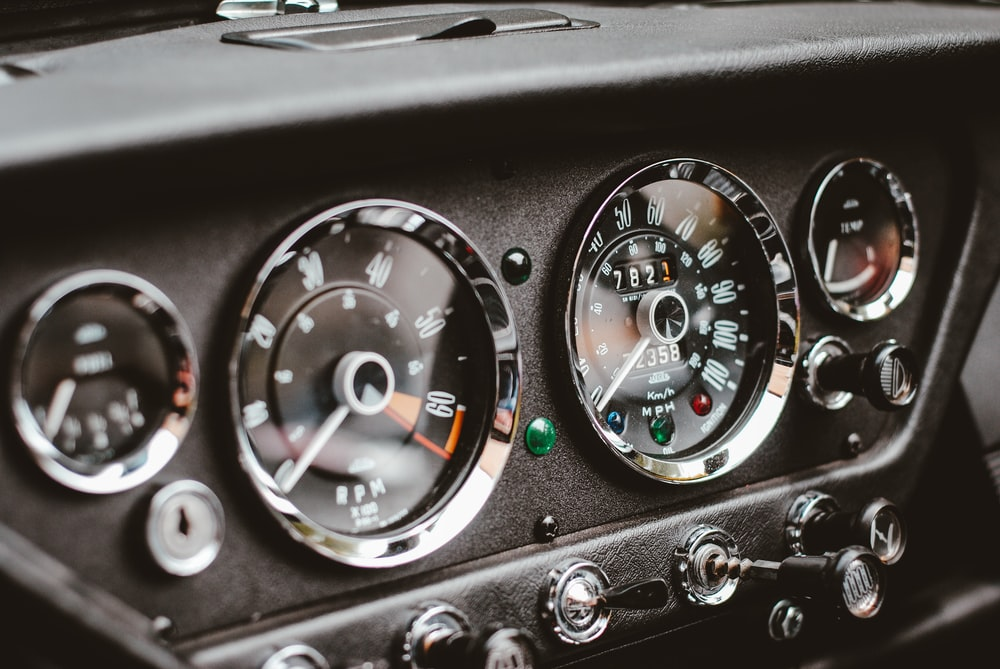 close photography of car instrument panel cluster